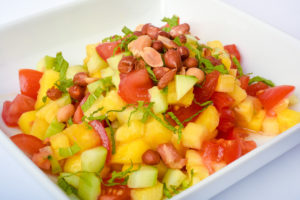 Mixture of tomatoes, cucumbers, mango, pineapple, mint leaves, spices and topped with Spanish peanuts.